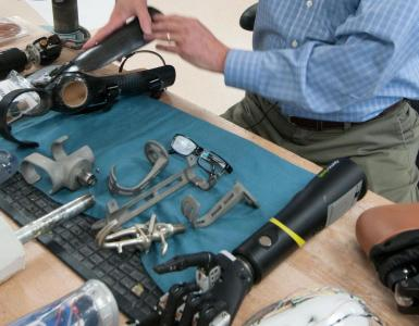 Multiple prosthetic devices on work bench